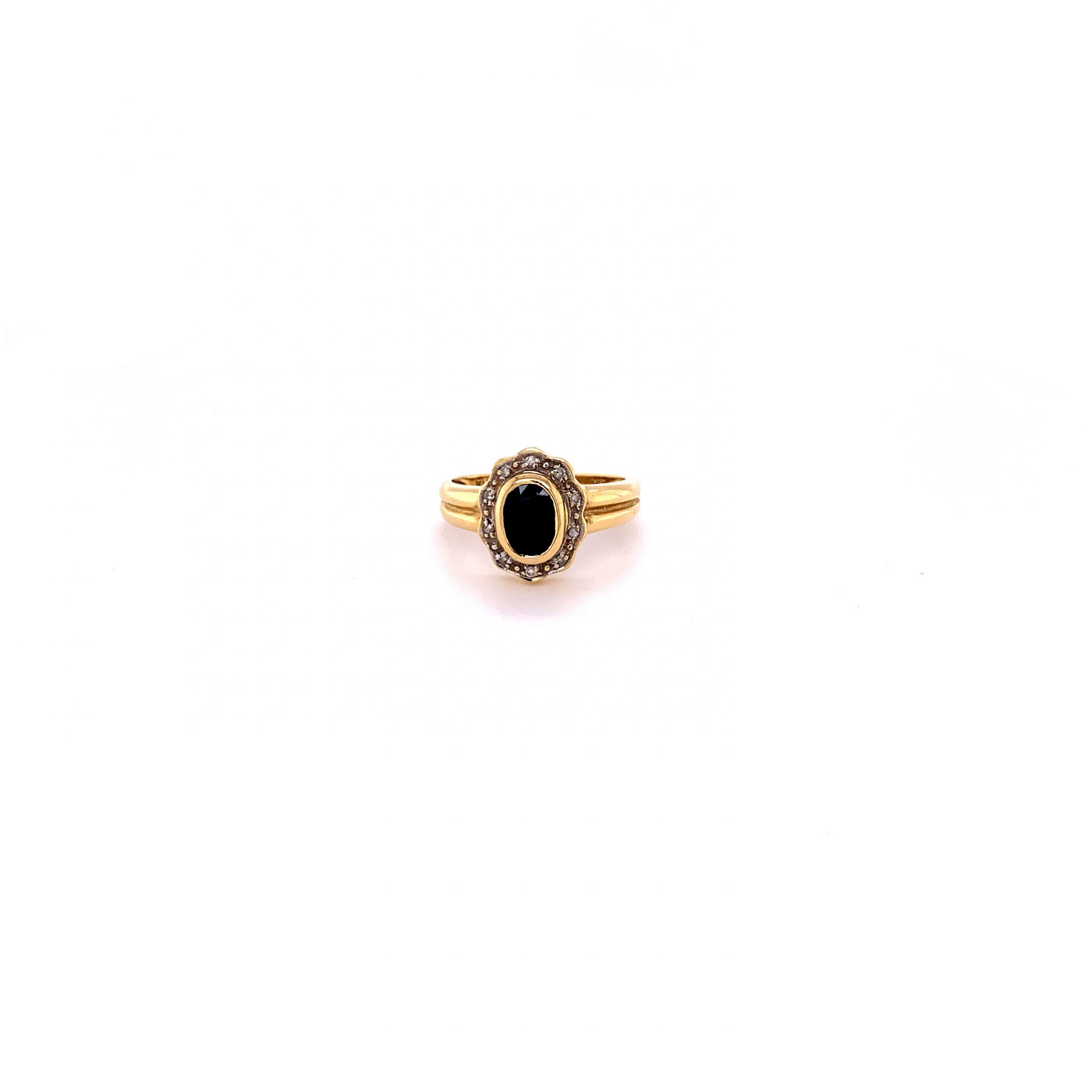 18k ring med safir och diamanter