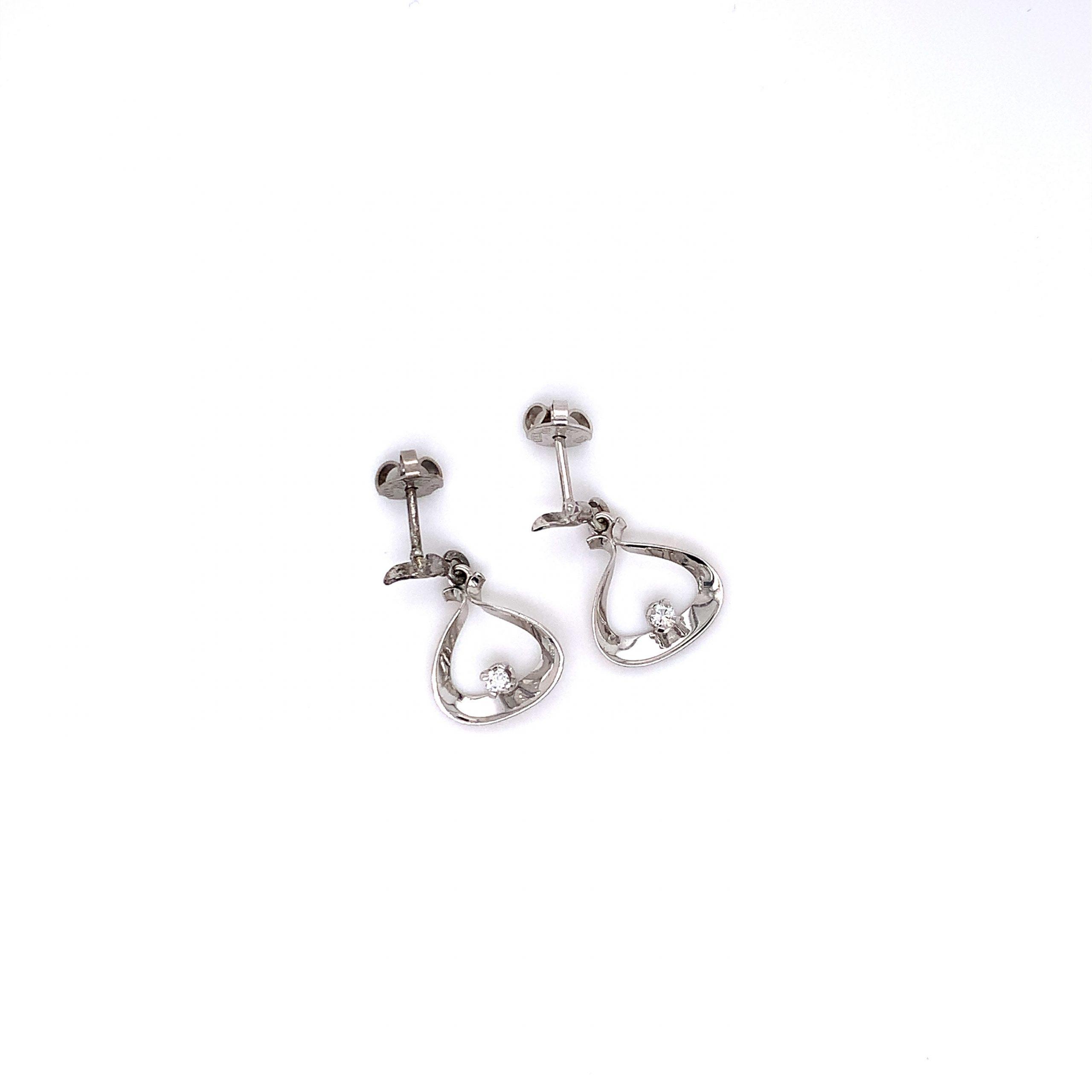 18k Vitguldsörhängen med diamant